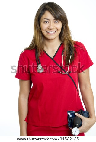 Beautiful multiracial female nurse or physician in red scrubs smiling and holding a sphygmomanometer used for determining blood pressure
