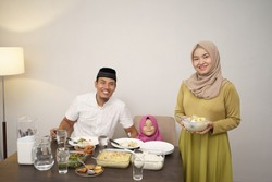 beautiful muslim family having dinner together. breakfasting concept during ramadan kareem