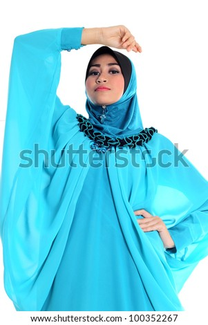 Beautiful Muslim fashion girl pose isolated on white