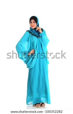 Beautiful Muslim fashion girl pose isolated on white - stock photo