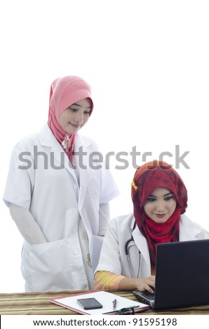 beautiful muslim medical doctors woman working with computer isolated on white background