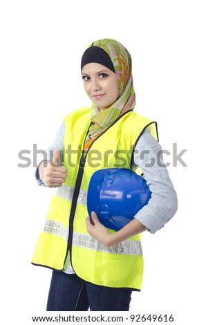 Beautiful muslim woman with personal protective equipment show thumbs up