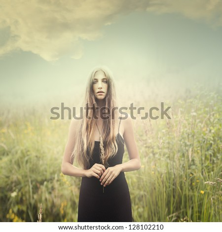 Stock Photo beautiful mysterious girl in a magical park