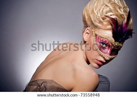 Stock Photo Beautiful mysterious girl in a Venetian mask