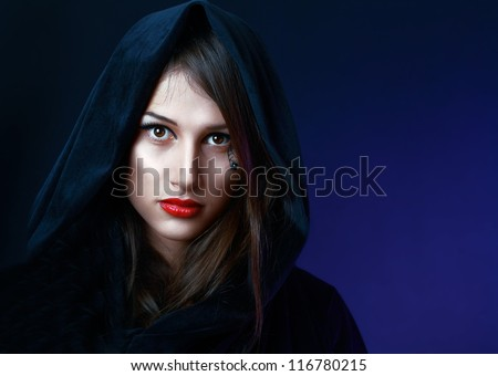 beautiful mysterious woman in black hood evil halloween witch look