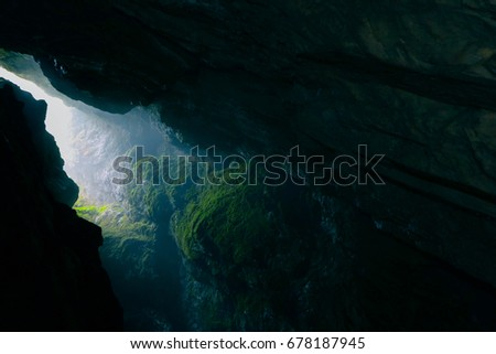 Beautiful mystic view from the underground of cave. Bulgaria, Devil throat cave, scary background.