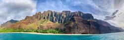 Beautiful Na Pali coast, Kauai, Hawaii view from off shore sea sunset boat cruise tour. Nature coastline landscape in USA. Hawaii travel. Panorama banner copy space on mountains.