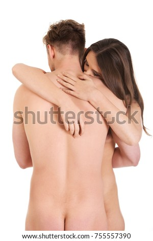 Beautiful naked couple in a tender embrace.