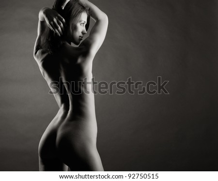 Beautiful naked female body. Black and white photo.