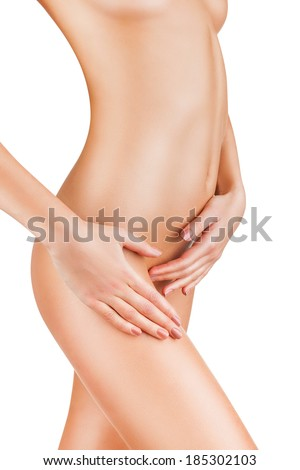 Beautiful naked female body isolated on white background