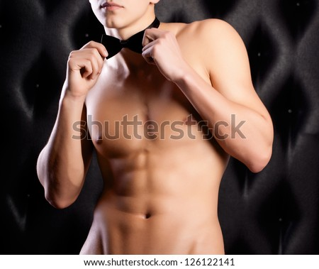 beautiful naked guy in a hat and bow tie