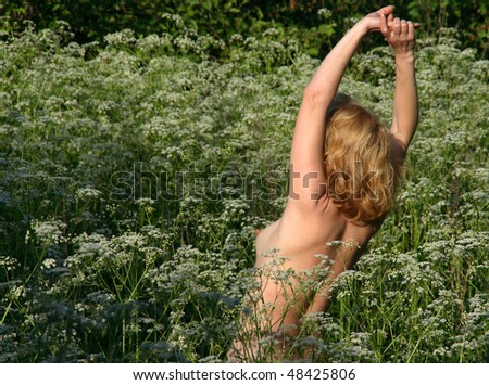 stock-photo-beautiful-naked-woman-on-grass-48425806.jpg