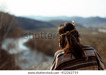 beautiful native indian american woman shaman  sitting on rocks and looking at woods and river - Shutterstock ID 412262719