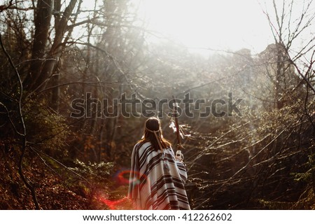 beautiful native Indian American woman walking on background of light woods #412262602 & Free photos Beautiful woman in native american costume with feathers ...