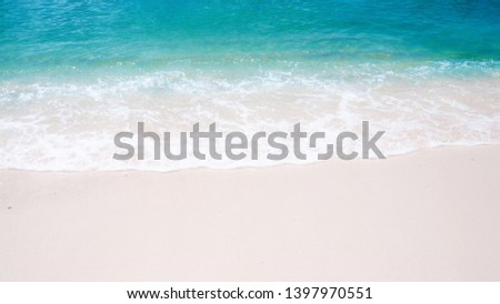 Beautiful natural background on white sand beach, green sea water And bubbles wave in the summer. Clean and pure environment on holidays #1397970551