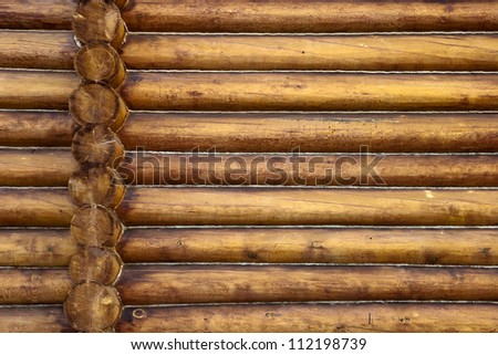 Beautiful Natural Background Pattern of a Log Wall - stock photo