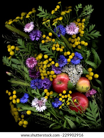 Beautiful natural composition made from apples and wild flowers - tansy, cornflowers and other