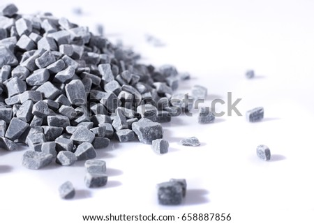 beautiful natural gray stones scattered on a white #658887856