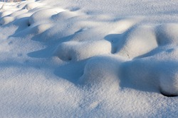 beautiful natural phenomena of the winter season, covered with a thick layer of snow after a cyclone with storms and snowfalls, cold frosty winter weather, snow drifts