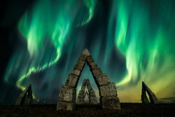 Beautiful natural phenomenon of Aurora Borealis as Northern Lights and the Arctic Henge in Iceland.