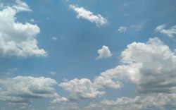 Beautiful natural scenery view of white cumulus clouds in the blue sky over the city, nature landscape photography, seasonal weather conditions and atmospheric moods