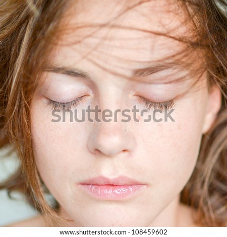 Beautiful natural sexy young woman with closed eyes