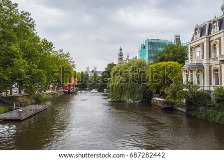 Beautiful Nature along the canals in Amsterdam - AMSTERDAM / THE NETHERLANDS - JULY 20, 2017 - Shutterstock ID 687282442