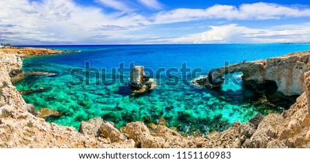 Beautiful nature and  cystal clear waters of Cyprus island. arch bridge near Agia napa calls