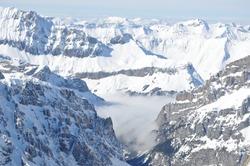 Beautiful nature landscape of Swiss Alps. Mountains covered with snow in Switzerland. Great view of the snowy rocks in Alpine ski resort Zermatt near Matterhorn mountain. Winter holidays background.