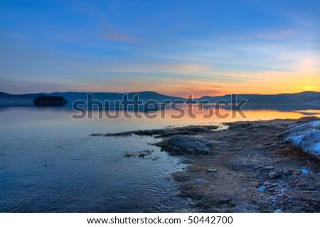 beautiful nature landscape; sunrise on the bulgarian Batak dam lake