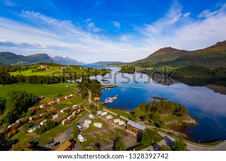 Beautiful Nature Norway natural landscape. Aerial view of the campsite to relax. Family vacation travel, holiday trip in motorhome RV. #1328392742