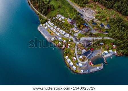 Beautiful Nature Norway natural landscape. Aerial view of the campsite to relax. Family vacation travel, holiday trip in motorhome RV. #1340925719