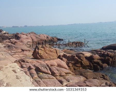 Beautiful nature of pink rock and sea located in pink granite coast at Chanthaburi, Thailand #1031369353