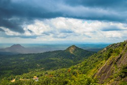 Beautiful Nature Scenery of Wayanad Edakkal Cave, blue cloudy sky with green mountains Kerala god's own country