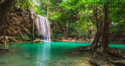 Beautiful nature scenic landscape Erawan waterfall in deep tropical jungle rain forest, Attraction famous landmark tourist travel Kanchanaburi Thailand vacation trips, Tourism destinations place Asia