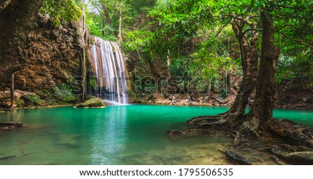 Beautiful nature scenic landscape Erawan waterfall in deep tropical jungle rain forest, Attraction famous landmark tourist travel Kanchanaburi Thailand vacation trips, Tourism destinations place Asia stock photo