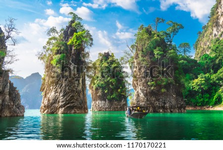 Beautiful nature scenic landscape view rock mountain Khao Sok national park with boat for travelers, Attractive famous popular place in Thailand, Destinations Scenery Asia, Water travel adventure trip