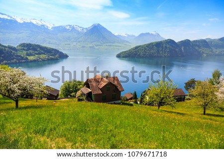 Beautiful nature view and houses on mountain slope with Luzern lake and mountains in background, view from Rigi Railways on the way to Rigi Kulm in Switzerland Stock fotó ©