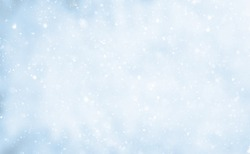 Beautiful Nature Winter background. Falling snow flakes on blurred blue and white background. Soft Christmas background With Copy Space for design