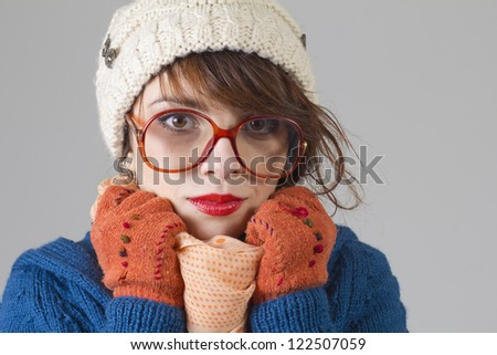 Beautiful nerdy woman in colorful winter clothes