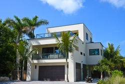 Beautiful New Florida House with Palms Trees and Landscaping Near the Beach. Would Make a Great Vacation Rental Property.