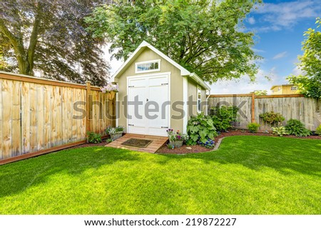 Beautiful new shed with flower bed on backyard area