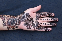 Beautiful New Simple Arabic Mehndi Design on the Woman's Hand in the Muslim Marriage Mehndi (Henna) Ceremony.
