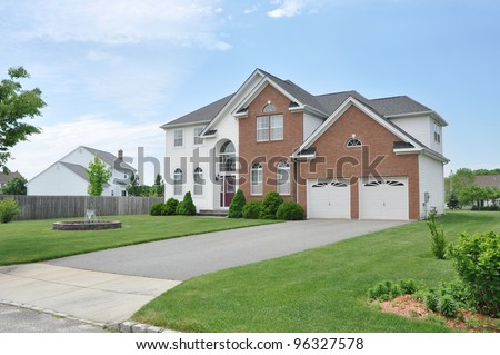 Beautiful New Suburban Brick Home Water Fountain centerpiece Two Car Garage Residential Neighborhood