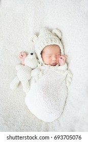 Stock photo of beautiful newborn baby with cute props