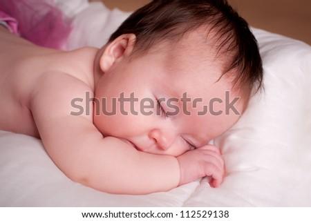 Beautiful newborn baby girl sleeping