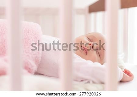 beautiful newborn sleep in crib