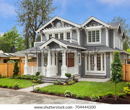 Beautiful, Newly Built Luxury Home Exterior with Covered Porch