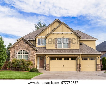Beautiful, Newly Built Luxury Home Exterior with Three Car Garage