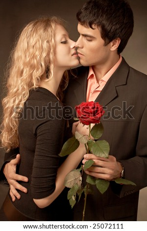 beautiful nice couple in love with rose - stock photo